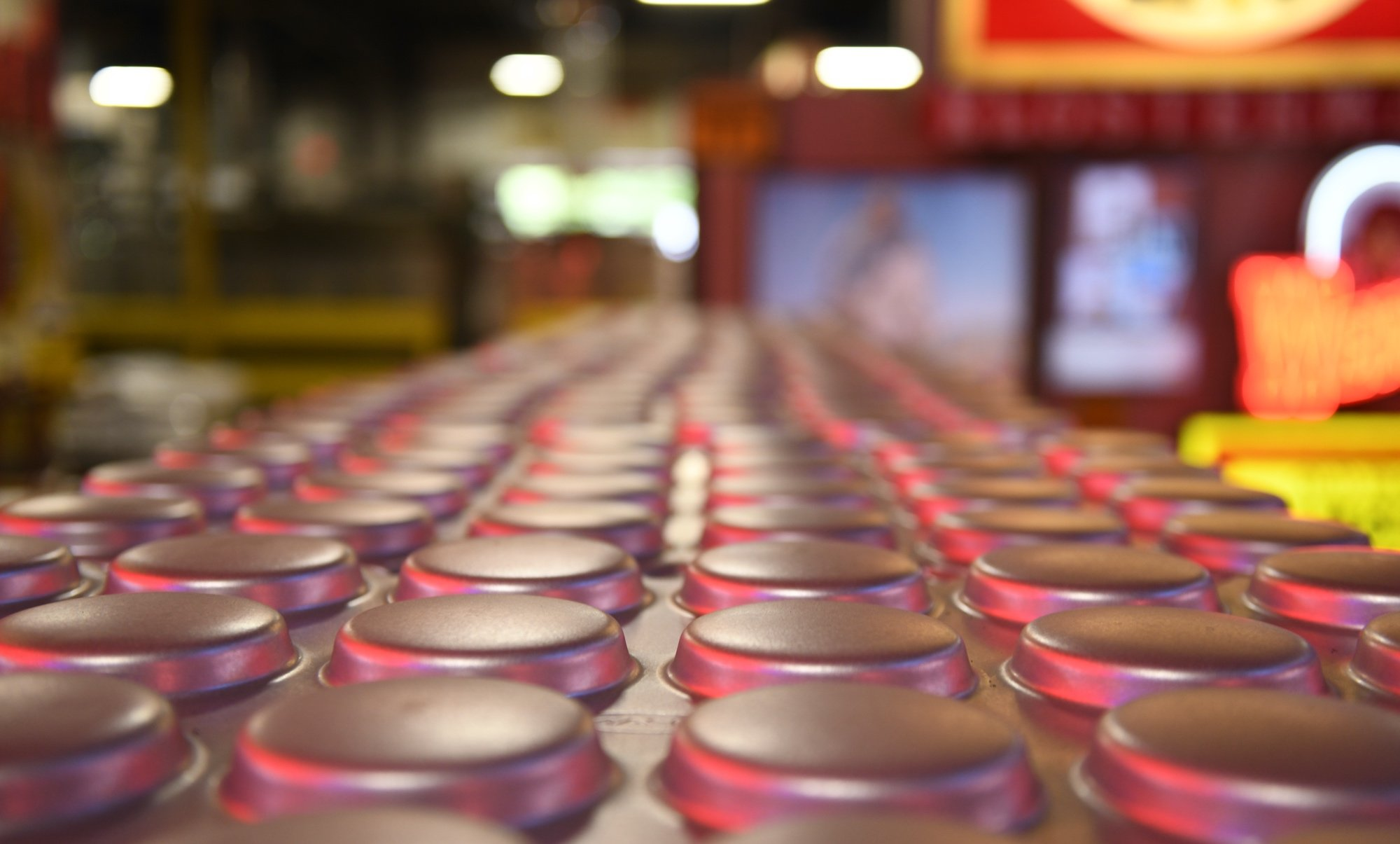 Chicago Metallic Pans under the neon lights at Bundy Baking Solutions